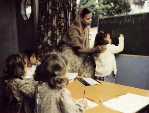 Harirani-devi dasi teaches the second of the three R's.