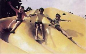 the boys have a ball on a slide near the school