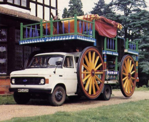the chariot has been compacted and hoisted onto a truck for the trip to the next festival.