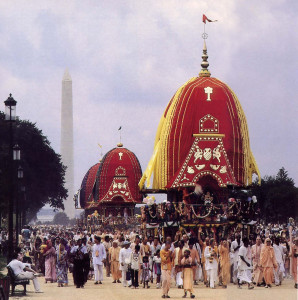 Regally enthroned on the lead chariot, Jagannatha, Lord of the Universe, rides in procession from the Washington Monument to the Capitol