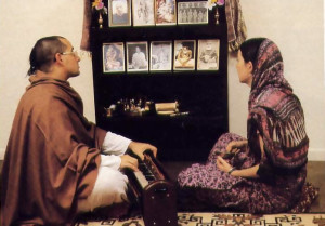 Sitarani and her husband, Subhananda, meditate at home by chanting the Hare Krsna mantra.
