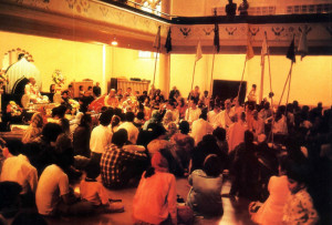 Before initiating new disciples at a recent ceremony in the Montreal temple (above), Srila Gopala Krsna Goswami (on red velvet seat of honor) explains the relationship between guru and disciple in Krsna consciousness.