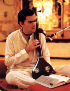 Nandikesvara dasa, leader of the Montreal center, play a traditional Indian tamboura as he sings the glories of Lord Krsna.