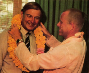 Australia's acting prime minister, Douglas Anthony (left), receives a sacred garland from Srila Bhavananda Goswami, one of the Hare Krsna movement's present spiritual masters.