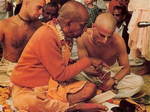 Srila Prabhupada instructs Yaduvara dasa in the pronunciation of the sacred Gayatri mantra after awarding him second, or brahminical, initiation.