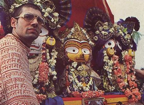 During Ratha-yatra country-style, Preraka dasa anends the deities of Lord Balarama. Srimati Subhadra-devi, and Lord Jagannatha.