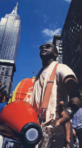 Urjasvat dasa chants the Hare Krsna mantra from the center of the Big Apple