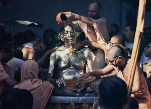 Devotees from JSKCON centers around the world lovingly bathe the large brass murti of Srila Prabhupada.