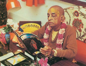 Srila Prabhupada inspects the November 1975 issue of BACK TO GODHEAD magazine