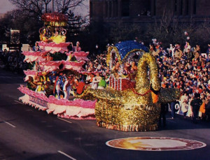 Drawn by a shimmering golden swan, Dallas ISKCON's lotus float glides past spectators at the twenty-seventh annual Cotton Bowl Parade.
