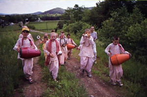 Haridasa (second from right) leads the boys on one of their regular sankirtana outings to the covered bridge