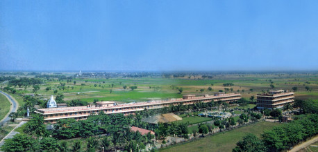 On the Ganges plain ninety miles north of Calcutta, the world headquarters of the International Society for Krishna Consciousness (ISKCON) rises in Mayapur, the land of Lord Caitanya's birth. The beautiful gardens and the first buildings of the Mayapur project provide a warm welcome for visitors.