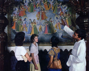 After dinner, many guests tour the Palace, where Ramasraddha dasa explains Lord Krsna's pastimes as depicted in the Rajasthani silk paintings of B. G. Sharma.