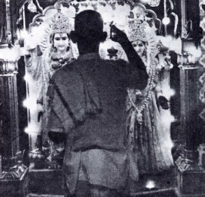 "A ""PURAJI"" OR PRIEST PERFORMS ""ARTI"", FORMAL WORSHIP OF THE LAKSHMI-NARA-YANA DEITIES"