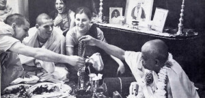 "The Spiritual Master returns the sanctifies beads to the new disciple: ""Your name is Vamanadev"""