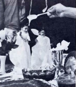A.C. Bhaktivedanta Swami bathes the Radha Krishna deities in milk before installation.