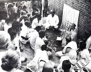 His holiness Acyutananda Maharaja, a disciple of His Divine Grace A.C. Bhaktivedanta Swami Prabhupada, lectures daily to a large gathering of people at a bathing ghat on the Ganges River.