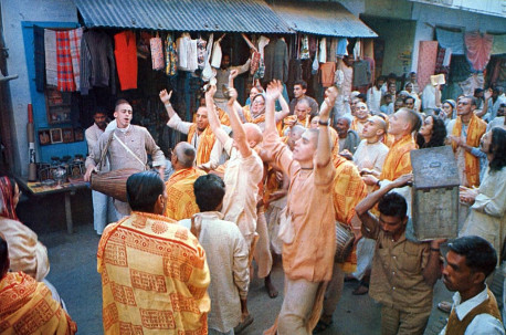 Devotees of the Krsna consciousness movement celebrate sankirtana - congregational chanting of the holy name of the Lord - in the streets of present-day Vrndavana.