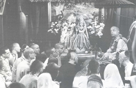 "Radha-Krsna Deities preside as Srila Prabhupada teaches disciples in London: ""The real guru is God's representative, and he'll talk about God and nothing else"