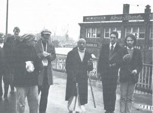 Depending upon Krsna: Srila Prubhupada and disciples walking on Hamburg's waterfront (1969). Sivananda is on the left, in front.
