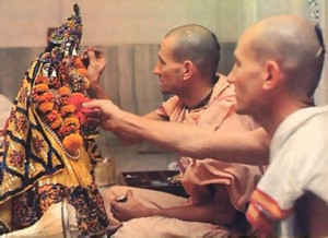 In the privacy or the altar room the brothers devotedly decorate RadhaMadhava in the early morning.