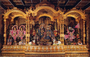 Sri Sri Radha-Vrndavanacandra (center) along with Sri Sri Gaura-Nitai (left) and Sri Nathaji (right), standing on a gold and silver altar, are the center of worship at New Vrindaban
