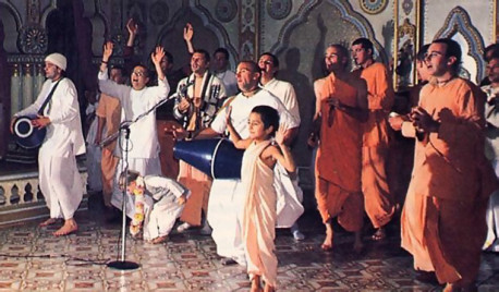 The congregational chanting and dancing as their elders chant HareKrsna to the accompaniment of drums and hand cymbals.