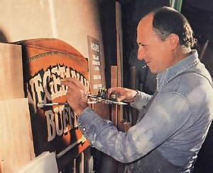 Karuna-sindhu dasa puts finishing touches on a sign for one of the restaurants