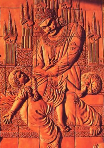 The artists cut each relief into sections and bake them in a kila. Then the sections are reassembled, as here on the wall of Srila Prabhupada's memorial shrine in Mayapur. This relief depicts the confrontation between the boy devotee Prahlada and his demonic father. In the final step, an artist will fill in the spaces between the sections with clay