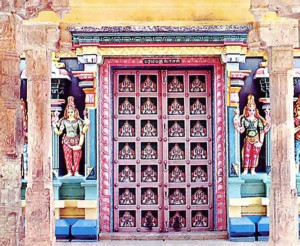 The main door of the temple is flanked by colorful reliefs.