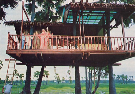 From the veranda of a tree house built for ISKCON, Srila Jayapataka Swami waves a greeting. One of the spiritual masters in the Hare Krsna movement, he is the overseer of its affairs in parts of the Far East.