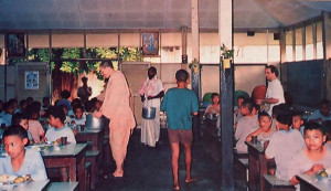 Ilapati dasa (in saffron) heads a program that provides free meals to the hungry