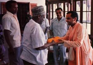 Zanzibar President Wakil receives a copy of Srila Prabhupada's Bhagavad-gita As It Is from Srila Navayogendra Swami.