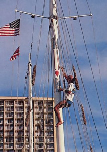 The large tilaka symbol adorning the Jaladuta II's mainmast receives a touch-up from French-Canadian Gauracandra dasa
