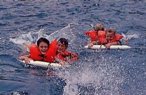 Children get a ride on life preservers just before a picnic lunch, served on deck.