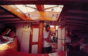 Narahari Swami keeps in touch with ISKCON 's farm community on Hawaii by radio, as crew members read from Prabhupada's books during the hot hours of the day.