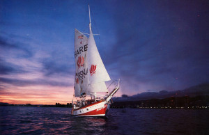 The lights of Waikiki and the pastels of dusk form a suitable backdrop for one of the Jaladuta II's sunset cruises