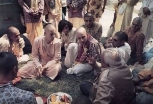 His Holiness Satsvarupa Gosvami, second from the left, meets with guests on the front lawn of the Mexico City Hare Krishna Temple.