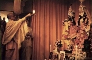 Srila Prabhupada offers aroti to Sri Sri Radha Paris Isvara