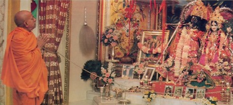 Srila Prabhupada prays to Their Lordships Sri Sri Radha Govinda at ISKCON New York City 1974