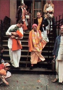 Srila Prabhupada and Hare Krishna devotees descending steps outside ISKCON New York Temple 1974.