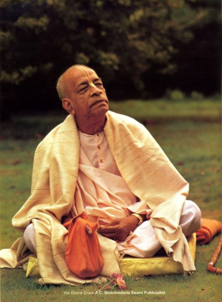 Srila Prabhupada sitting on lawn at Bhaktivedanta Manor, 1974.