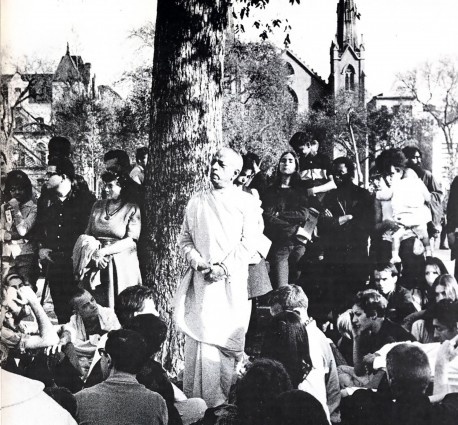 Srila Prabhupada standing under a tree and preaching Krishna consciousness in Tompkins Square Park New York City, 1966.
