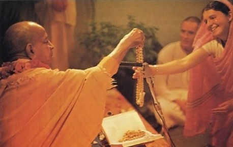 Srila Prabhupada initiates his disciples in the authorized Vedic way of spiritual understanding.