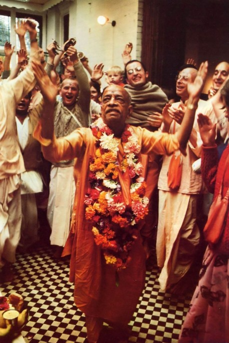 Srila Prabhupada dances in front of the Deities, Sri Sri Radha Gokulananda, at Bhaktivedanta Manor near London. 1974.