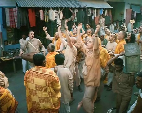 ISKCON devotees hold sankirtana, congregational chanting of the Hare Krishna mantra, in the streets of Vrindavan. India. 1974.