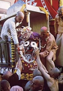 Devotees lift Lord Krishna, in His form as Lord Jagannatha, to His place on His float. San Fransisco, 1975.