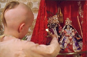 Dvlirakadhisa dasa offers a lamp to Krishna. ISKCON Gurukula Dallas Texas 1975.