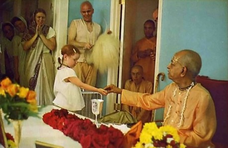Benediction. Srila Prabhupada, on a visit to Gurukula, hands out sweets to the students.