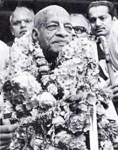 His Divine Grace A. C. Bhaktivedanta Swami Prabhupada flanked by Indian admirers. 1975.